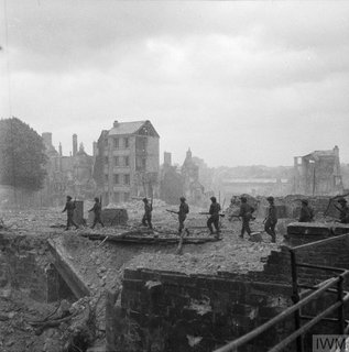 Caen, shown here with significant war damage, was bombed by the Allies on D-Day © IWM B 6897