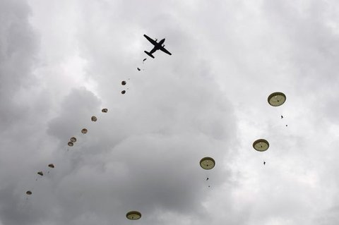 Parachutists over Normandy in a re-enactment of D-Day (image: MoD)